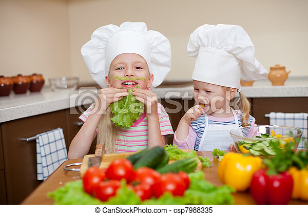 two little girls preparing healthy food and have fun  on kitchen - csp7988335