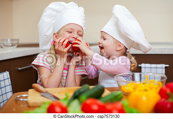 two little girls preparing healthy food on kitchen - csp7573130