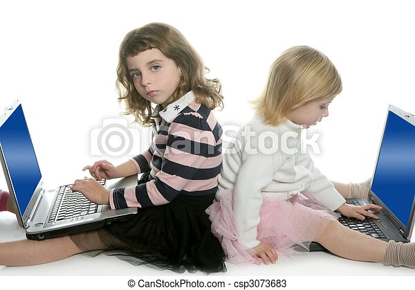 two little girls sister with computer laptops - csp3073683