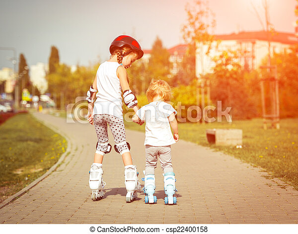 two little sisters in a roller skates - csp22400158