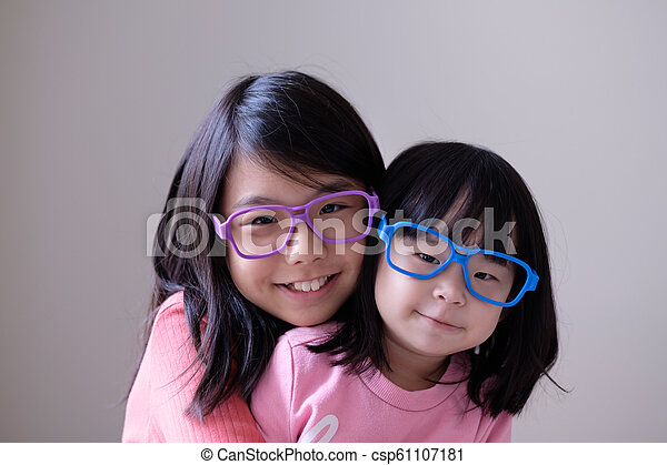 Two little sisters with big eyeglasses - csp61107181