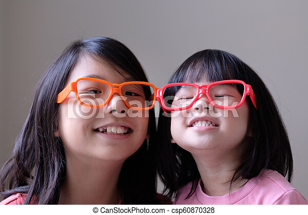 Two little sisters with big eyeglasses - csp60870328