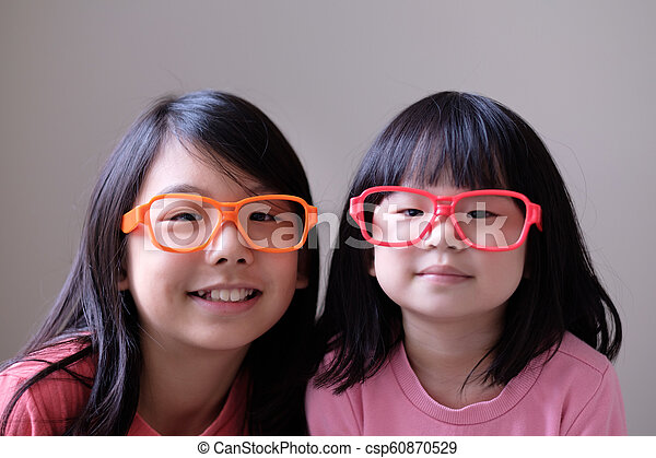 Two little sisters with big eyeglasses - csp60870529