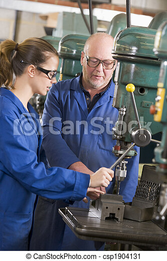 Two machinists working on machine - csp1904131