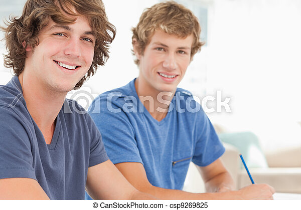 Two male students looking into the camera and smiling - csp9269825
