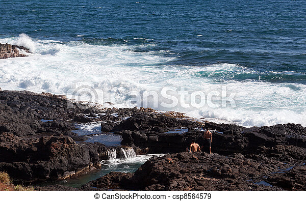 Two men looking to jump into ocean - csp8564579