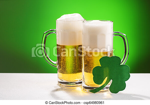 Two mugs of beer. Concept for St. Patrick's day. - csp64980961