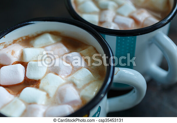 Two mugs of hot cacao with marshmallow - csp35453131