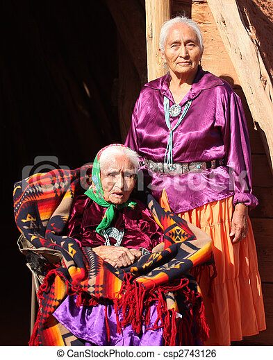 Two Navajo Women in Traditional Clothing Who Are Mother and Daughter Outdoors - csp2743126