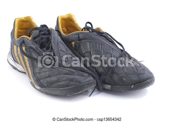 965e0963a two old black soccer shoes.