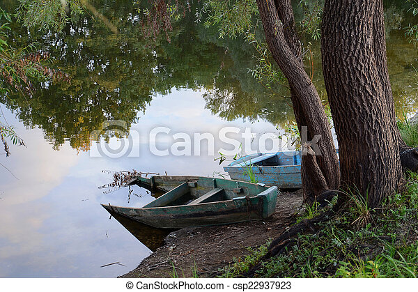 Two old boat on the river - csp22937923