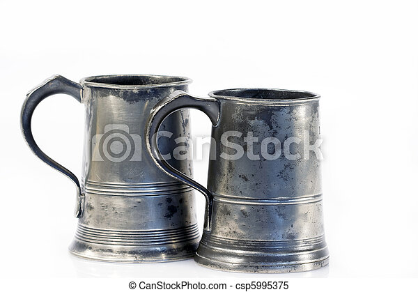 Two old quart pewter drinking jars isolated on white - csp5995375
