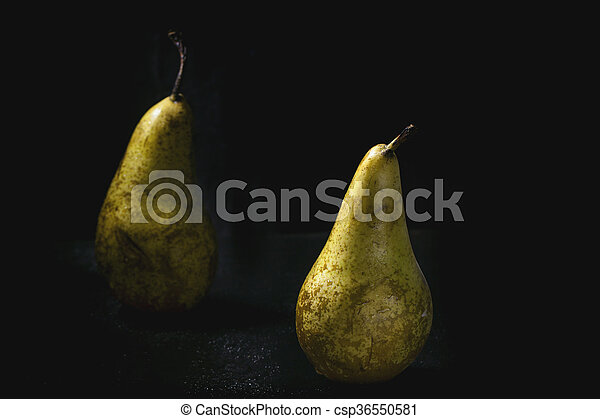 Two pears over wet black background - csp36550581