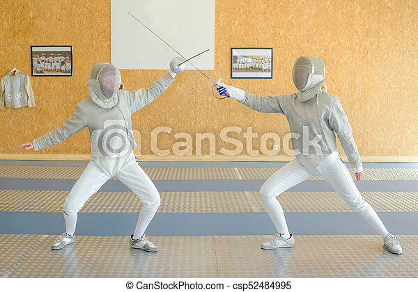 Two people fencing - csp52484995