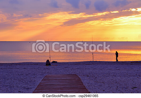 two people fishing by the sea - csp29461065