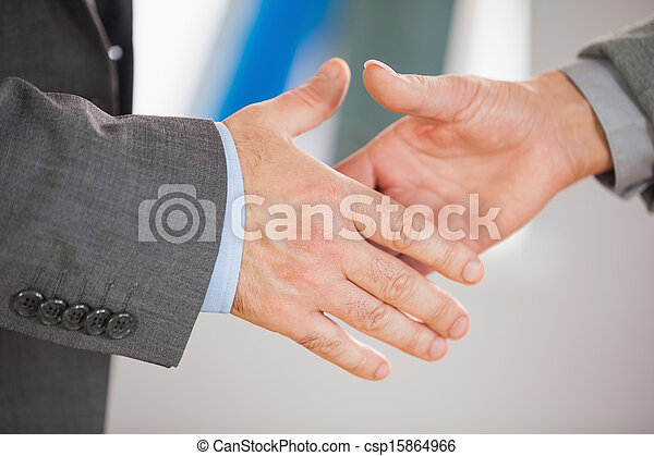 Two people going to shake their hands - csp15864966