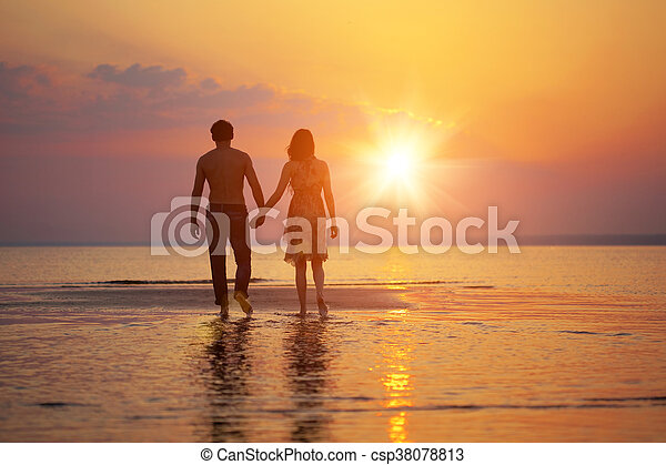 Two people in love at sunset - csp38078813