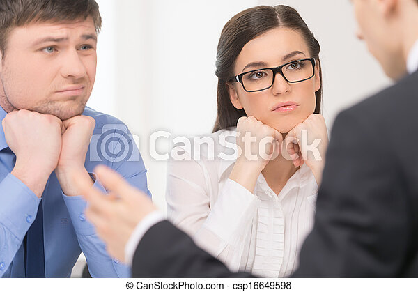 Two people listening to man. Woman with attention and man with bored face.  - csp16649598