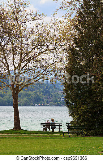 Two people on a bench - csp9631366