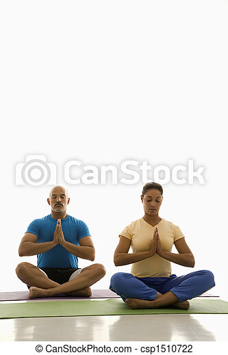 Two people practicing yoga. - csp1510722