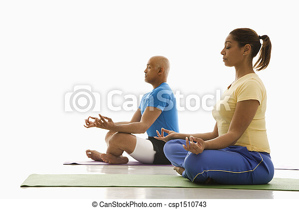 Two people practicing yoga. - csp1510743