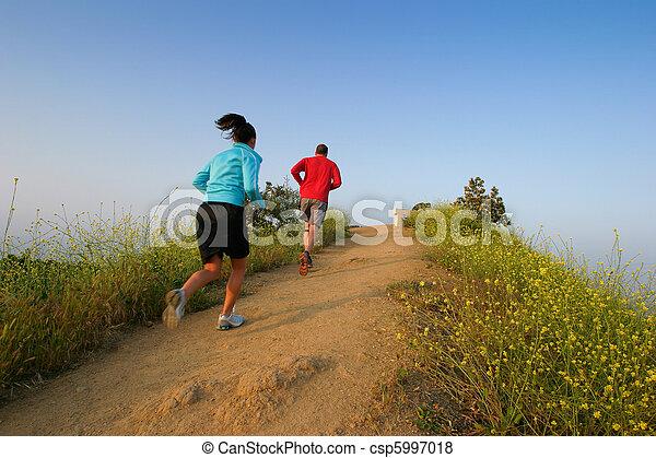 Two people running at Runyon Canyon Park, Hollywood Hills, California USA - csp5997018