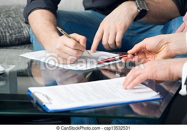 Two people signing a document - csp13532531