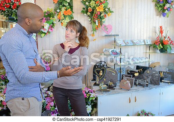two people talking at a funeral-home - csp41927291