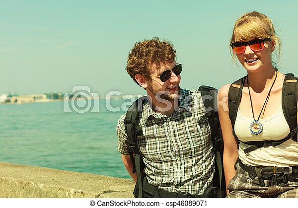 Two people tourists hiking by sea ocean. - csp46089071