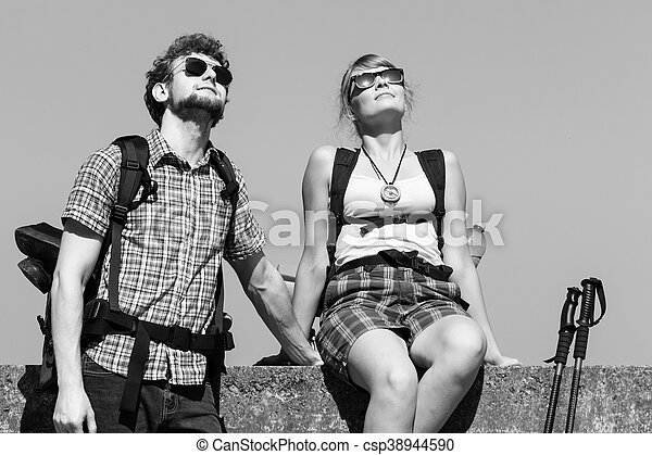 Two people tourists hiking by sea ocean. - csp38944590