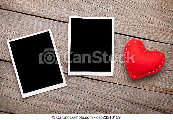 Two photo frames and valentines day toy heart - csp23310159