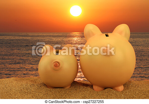 Two piggy banks on the beach looking to the sunset - csp27227255