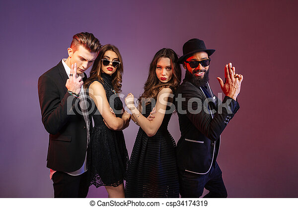 Two playful men and women posing together - csp34174319