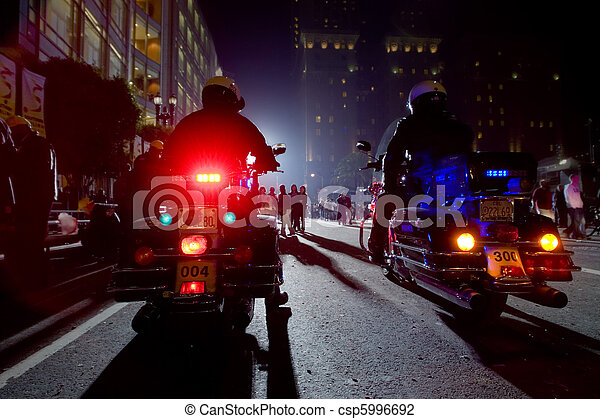 Two Police Officers On Motorcycles In A Night City. - csp5996692