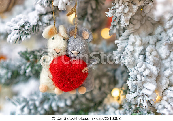 two rats hanging on a Christmas tree, holiday decoration - csp72216062