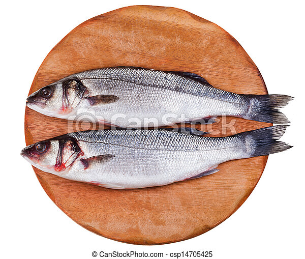 two raw seabass on wooden board - csp14705425