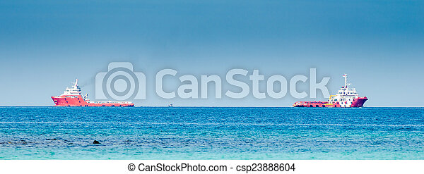 Two red cargo ship on the sea - csp23888604