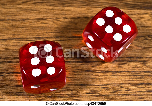 Two Red Dice on a Table - csp43472659