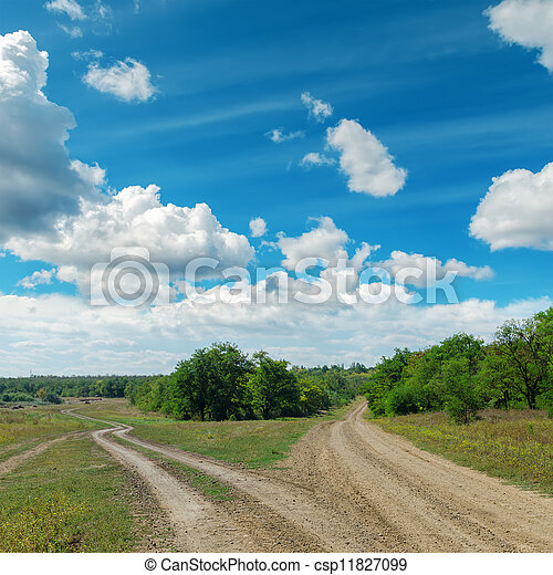 two rural road to horizon under cloudy sky - csp11827099