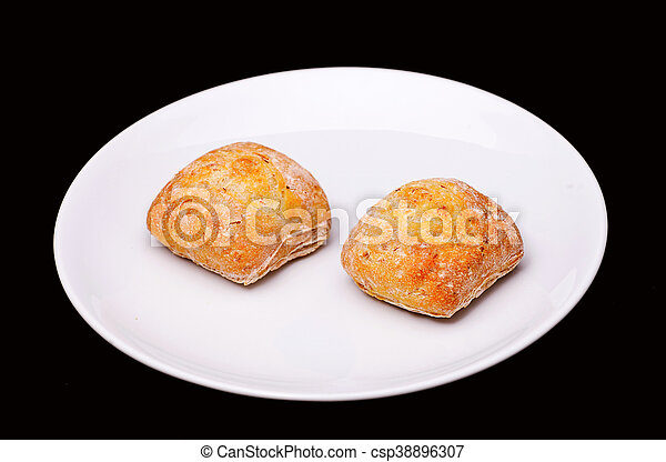 Two sandwich buns on white plate - csp38896307