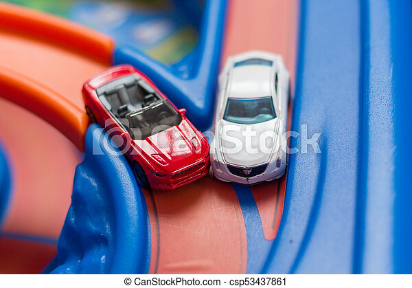 Two scale model toy cars accident on the road. Traffic jam. Stupidity. - csp53437861