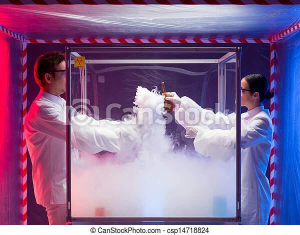 two scientists conducting tests in sterile chamber - csp14718824