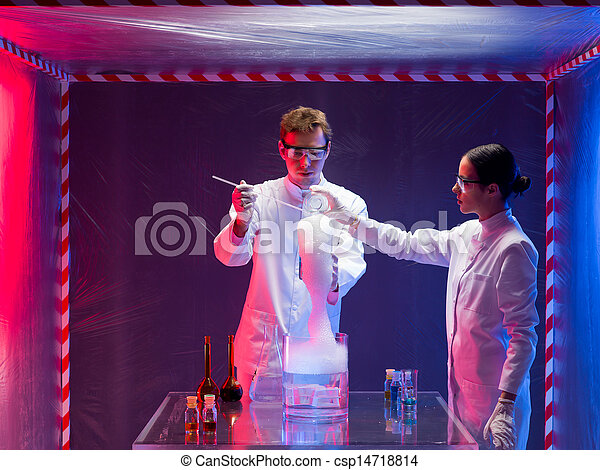 two scientists mixing chemicals in lab - csp14718814