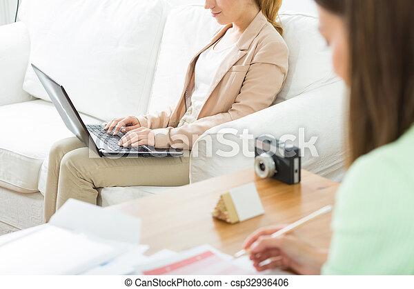 Two self-employed creative women - csp32936406