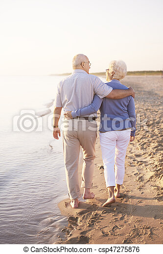 Two senior adults by the ocean - csp47275876