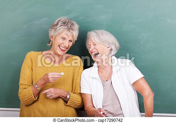 Two senior women sharing a good joke - csp17290742