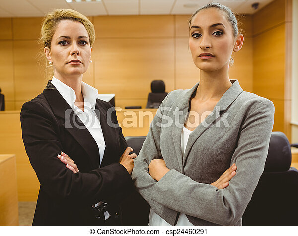 Two serious lawyers standing with arms crossed - csp24460291