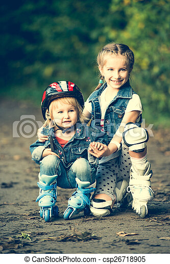 two sisters on roller skates - csp26718905