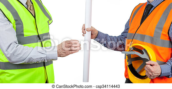 Two site surveyors in high visibility vests handing over site plans - csp34114443