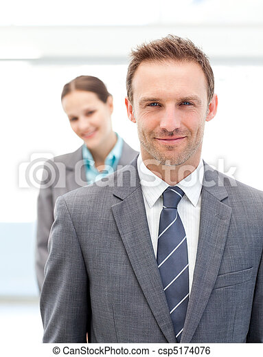 Two smiling business people posing in a row - csp5174076